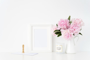 Stylish white a5 blank frame mockup. Still life composition, floral bouquet of pink peonies in jug, gold stamp and con. Background, mock up for quote, promotion, headline, design and social media