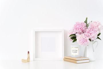 White square blank frame mockup. Feminine still life composition, floral bouquet of pink peonies in vase. Background, mock up for quote, promotion, headline, design, lifestyle bloggers