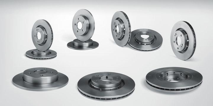 Set of brake discs on white background, car parts