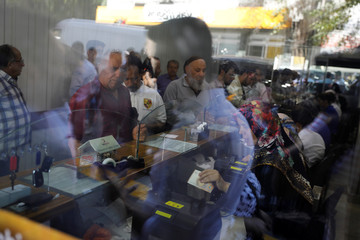 Businessmen change money at a currency exchange office in Ankara