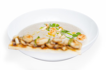 Cream mushroom soup with scallops and some herbs.