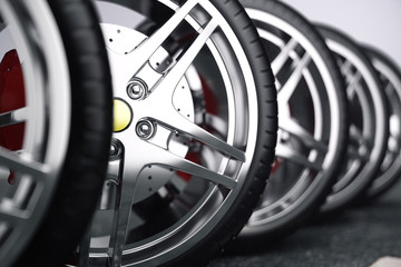 Car wheel, car tire standing on a road. Concept tyres. Car tire with a disc standing on the asphalt road. 3D illustration