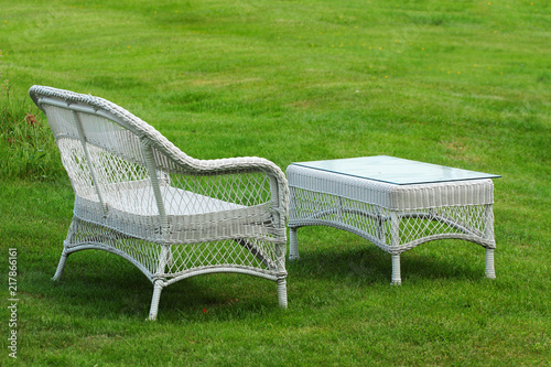 Fantastic Empty White Plastic Woven Bench And Table On A Green Lawn Ncnpc Chair Design For Home Ncnpcorg