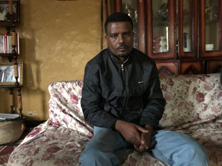 Recently released from prison, Ethiopian torture survivor and former political prisoner Keyfalew Tefera, poses during a Reuters interview in Addis Ababa