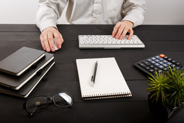 Close up of man accountant or banker making calculations. Savings, finances and economy concept