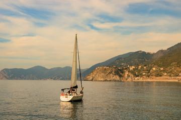 Photo of sailboat at sunset in Manarola, Cinque Terre, Italy.