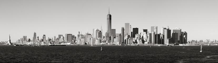 Panoramic Black & White view of Lower Manhattan skyscrapers from New York Harbor. New York City