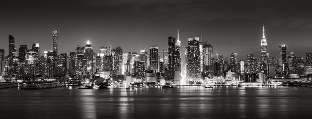 Fototapeta Panoramic Black & White view of Midtown West skyscrapers with the Hudson River. Manhattan, New York City