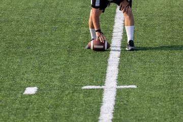 Referee setting football on field