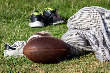 Football gear laying on practice field