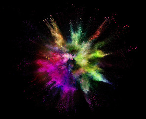 Coloured powder explosion isolated on black background