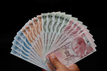Turkish lira banknotes are seen in this picture illustration in Istanbul