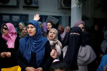 Palestinian UNRWA employees take part in a protest against jobs termination by UNRWA inside its headquarters in Gaza City