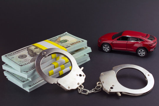 Red car  money handcuffs. shopping for vehicles fraud car sale, breaking the law auto dealer concept.