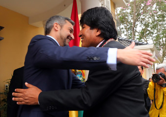 Paraguay's President-elect Abdo Benitez welcomes Bolivia's President Morales at his home ahead of the August 15 swearing-in ceremony in Asuncion