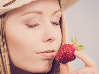Young woman with fresh strawberry