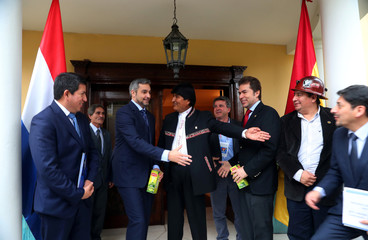Paraguay's President-elect Abdo Benitez and Bolivia's President Morales gesture outside Benitez' home ahead of the August 15 swearing-in ceremony in Asuncion