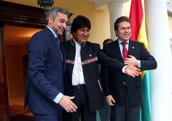 Paraguay's President-elect Abdo Benitez, Bolivia's President Morales and Benitez' Foreign Minister Castiglioni meet at Benitez' home ahead of the August 15 swearing-in ceremony in Asuncion