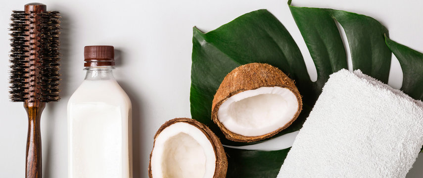 Coconut oil and tropical leaves. Hair care spa concept. Toned