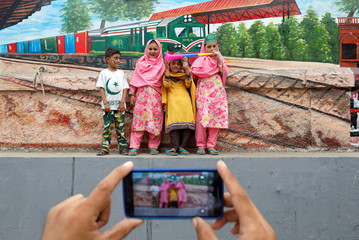 Children pose for a photograph while celebrating the country's 71st Independence Day in Karachi