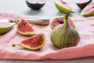 figs on a pink napkin, cut, tropical fruit, concept, copy space