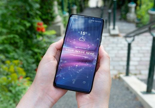 Smartphone Held in Two Hands Mockup