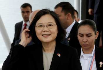 Taiwan's President Tsai Ing-wen gestures after arriving for the August 15 swearing-in ceremony at the Silvio Pettirossi International Airport in Luque