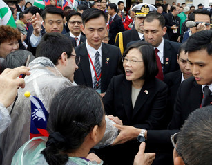 Taiwan's President Tsai Ing-wen is greeted by members of the Taiwanese community in Paraguay after arriving for the August 15 swearing-in ceremony in Luque