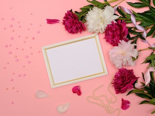 Frame of White and Pink Peony Flowers, Branches, Leaves and Petals With Space for Text on Pink Background. Home Decor. Flat Lay, Top View.