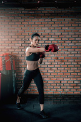 Asian sport woman wear boxing glove  in the gym,Thailand people workout,The best of fighther,Strong woman