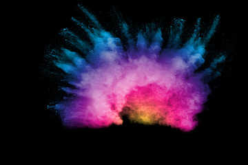Explosion of color powder on black background. Splash of color powder dust on dark background.