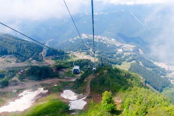 Aibga Ridge. Mountain Kamennyy stolb. 2509m. Mountains near the ski resort. cable car on the mountain going into the clouds