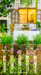 Relaxing area in cozy home garden on summer./ Beauty and relaxing garden with flower pot decoration in cozy home flower garden on summer.