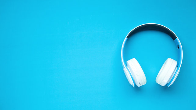 White headphones on a blue background.