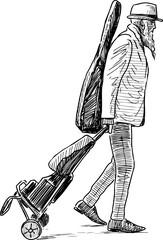 An elderly musician on a trip