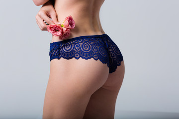 Woman wearing blue lace panties
