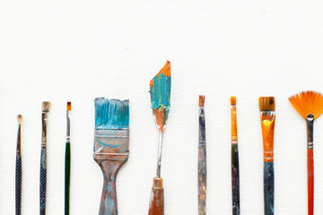 Vintage brushes and artist tools on a white background. View from above