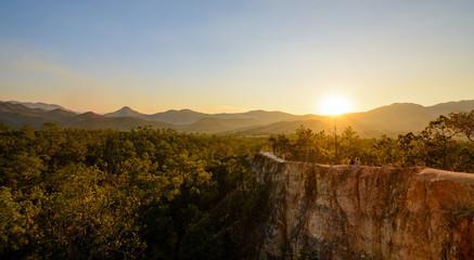 A beatiful sunset panorama with two hikers at Pai Canyon (Kong Lan), Maehongson, Northern Thailand.