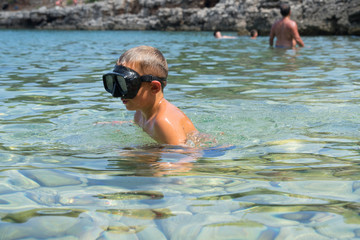 the boy in the mask swims and dives in Turkey