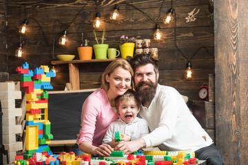 Nursery concept. Nursery child with man and woman in play room. Nursery and kindergarten. Nursery school