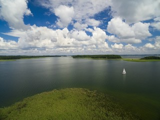 Aerial view of yachts sailing on Mamry Lake, Upalty - the biggest Masurian island in the background, Mazury, Poland