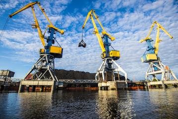 A view of the port cranes against blue sky. Riga, Latvia