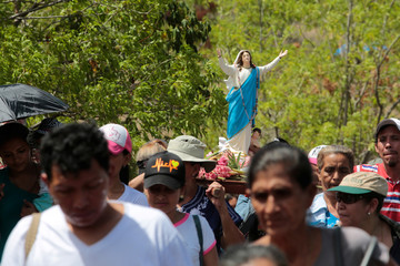 Catholics carry a statue of the Virgin Mary during a pilgrimage to demand an end to violence in Nicaragua near Cerro Negro Volcano in Leon