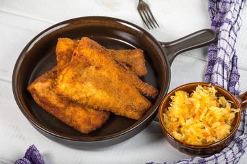 Pieces of cod in breadcrumbs.