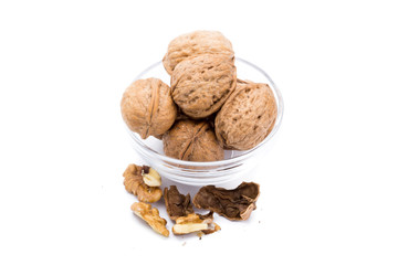 Container with large nuts isolated on a white background