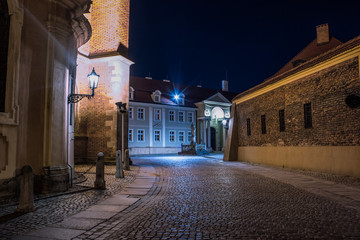 soft focus long exposure old city view concept of empty medieval street with illumination and dark blue sky without people and romantic atmosphere
