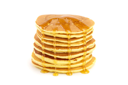 Pancakes stack with honey isolated on white background closeup