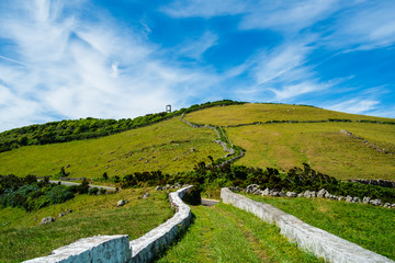 Path to a green mount with blue sky in Flores island in Azores