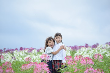 Two girls hugging happily