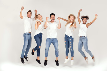 Group of smiling people jumping,having fun together.
